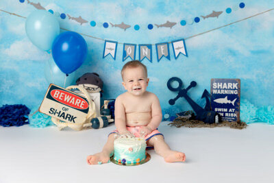 Monsters Inc inspired cake smash session of a little boy in blue and green
