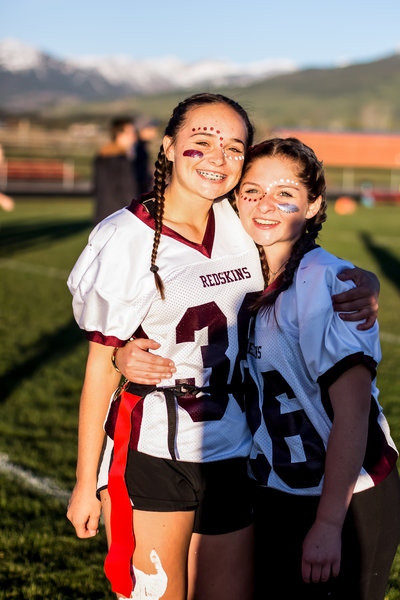 Jackson Hole Wyoming, Teton Valley, Driggs Idaho, sporting event photographer, football game details, high school football, homecoming, pretty cheerleaders, photographer, girl's flag football, powder puff game