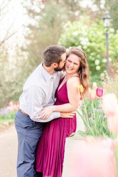 Photo of an engaged couple at the State Botanical Gardens of Georgia in Athens for their engagement session by Jennifer Marie Studios.
