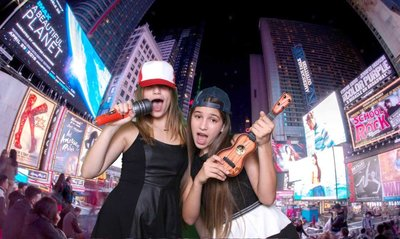 girls holding an guitar an a icrophone in NY with green screen