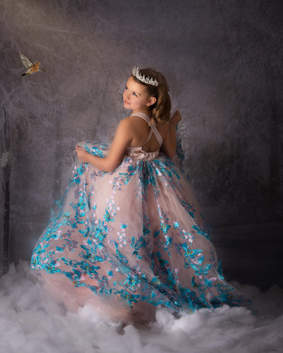 Pretty child in forest with blue princess dress