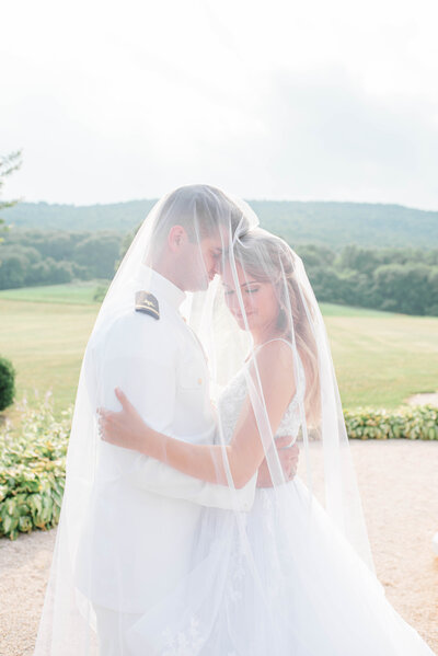 Bride and groom kiss under veil at Piedmont Golf Club wedding
