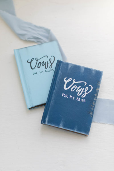 blue and light blue linen vow books for wedding