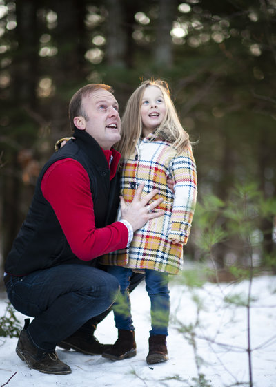 Father & daughter smiling in nature during family portrait session in Falmouth, Maine
