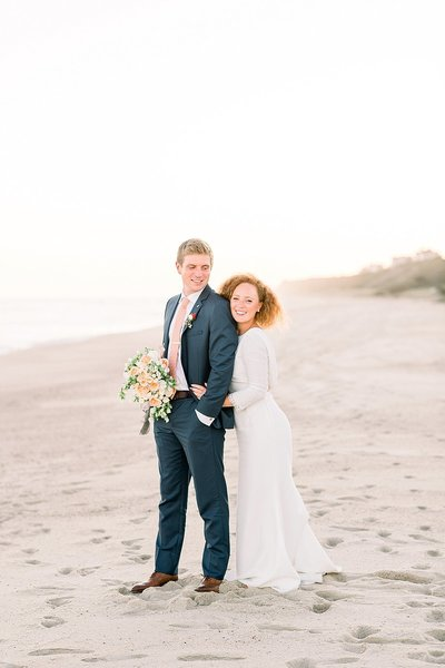 Whitney and Rob pose for photos on the beach after their Whale's Watch Nantucket Wedding