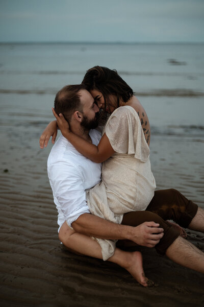Couple Pose on Beach on Gooseberry Island Anniversary Session