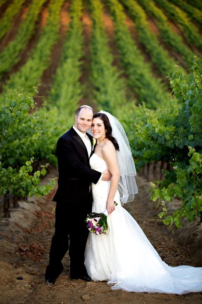 Bride and Groom in vineyard at Leoness Winery