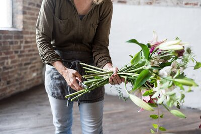 Nashville florist cutting the stems of a bouquet