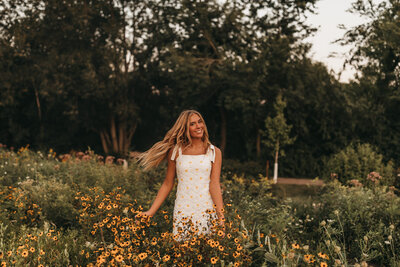 Sioux Falls senior session walking through sunflowers