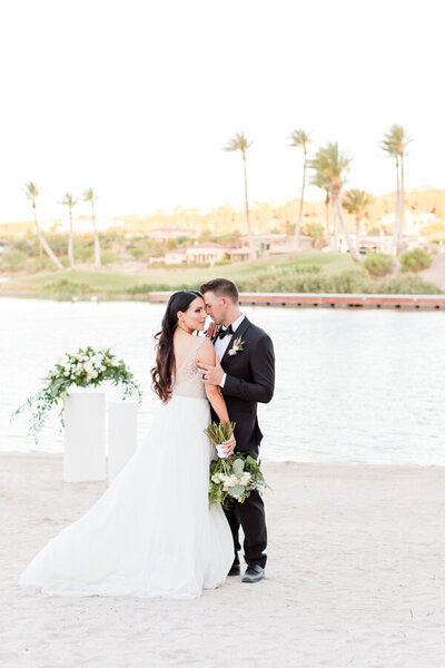 Bride and Groom kissing at Reflection Bay Lake Las Vegas Wedding