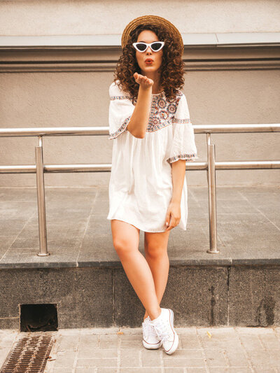 beautiful-smiling-model-with-afro-curls-hairstyle-dressed-summer-hipster-white-dress_158538-882