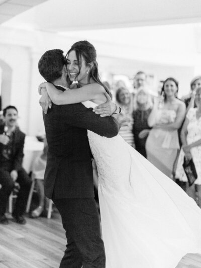 Elegant black tie wedding  ballroom first dance with guests