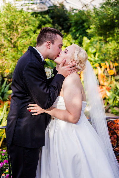 Bride and groom share first kiss at Phipps Conservatory wedding in Pittsburgh, PA
