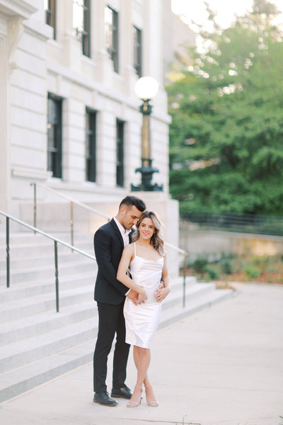 A Greensboro wedding photographer captures a couple during their modern engagement session downtown.