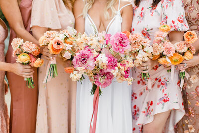 Pink and peach wedding bouquet and bridesmaid bouquet florals at Korakia Pensione wedding. Photograph taken by Cheers Babe Photo.