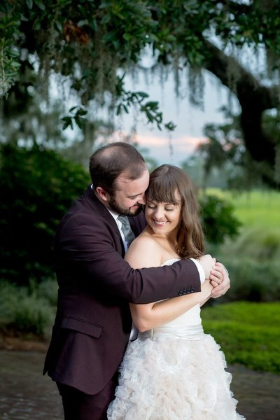 Bride and groom hold each other and smile at Heritage Plantation