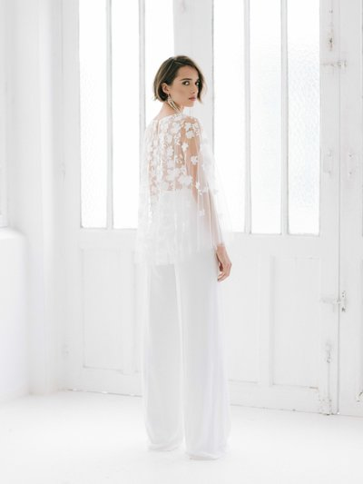 MARKLE Rime Arodaky effortlesly chic bridal jumpsuit with crepe trousers and a short wedding cape with lace details 05