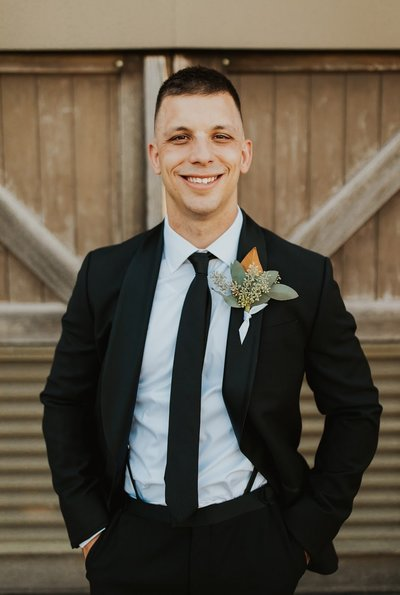 A groom with a unique floral boutonniere