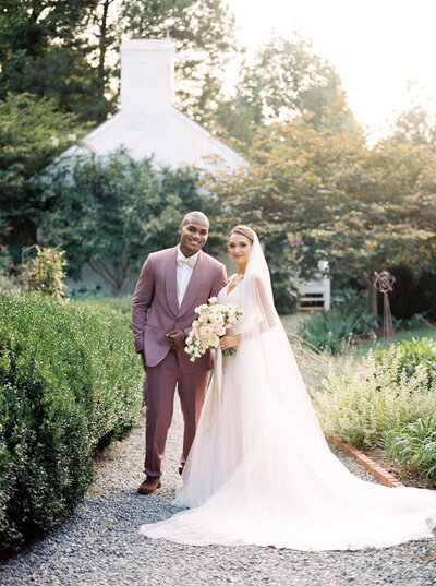 Romantic and whimsical wedding portraits with lush red florals at Meridian House DC wedding Venue