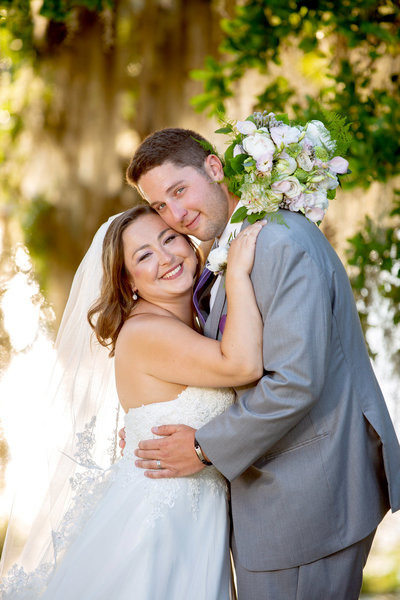 newlyweds smile for a portrait at Wachesaw Plantation