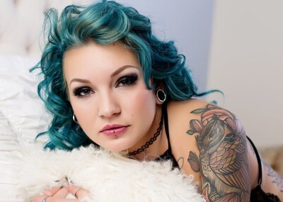 Blue haired woman posing for a boudoir portrait at boudoir by Janet Lynn