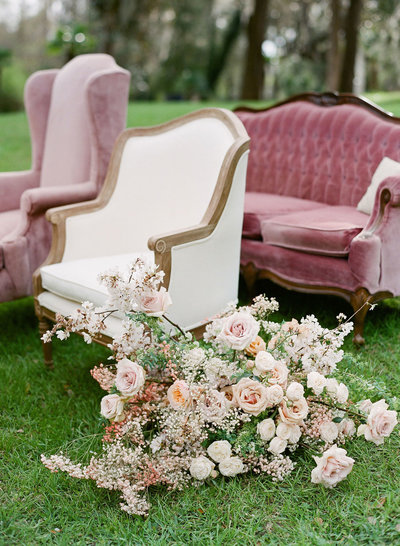 Velvet wedding chair and flowers at Middleton Place, Charleston