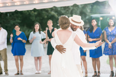 Charlotte wedding photographer shot of First dance at the Island House in Charleston, SC