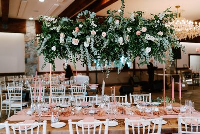 Wedding Reception Head table with unique  floral centerpiece using copper rods