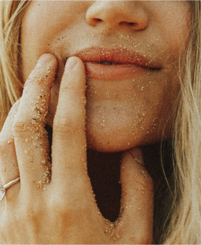 woman-sand-on-face@2x