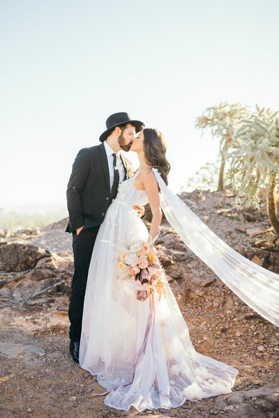 Newlyweds kiss in the morning sunlight in Tempe, Arizona