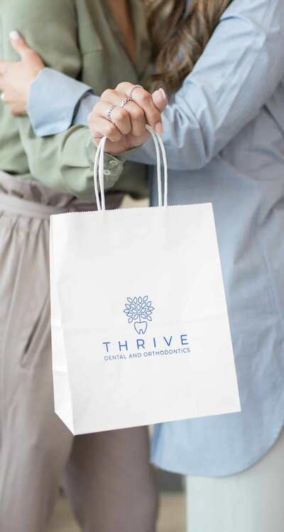 Thrive Dental Frisco Take Home Bag with Thrive Dental Logo