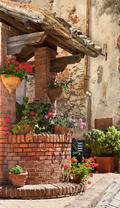 Ancient construction decorated with flowers in the city Volterra
