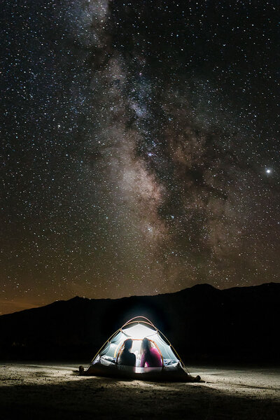 couple in tent under the stars