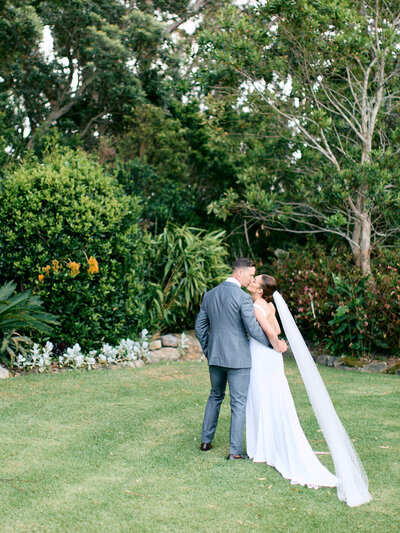 Bride and groom in garden at Tumbling Waters Retreat