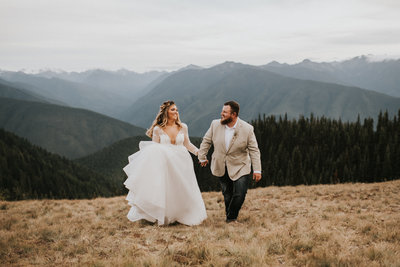 Couple walking in mountains after Hurricane Ridge elopement