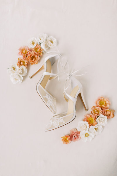 wedding bride shoes with pink and peach flowers