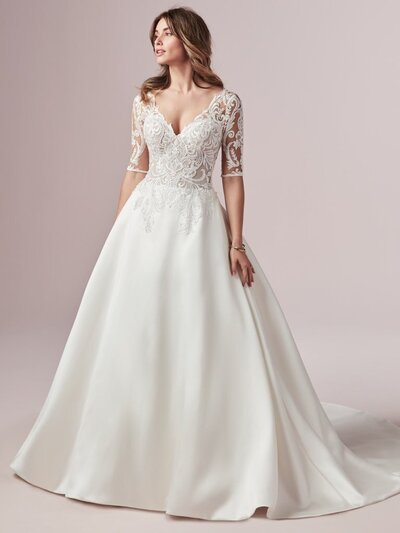 A-Line Lace Wedding Dress with Sleeves. Modern Royalty 101: ditch the overstuffed silhouettes, keep the satin, amp up the boho charm. This A-line wedding dress with sleeves is designed with shimmer and shine.