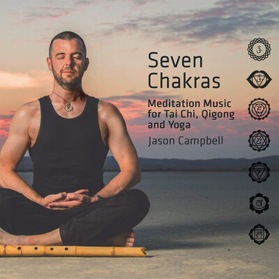 Album Cover Seven Chakras Jason Campbell sitting in lotus position in desert at sunrise wood flute on sand in front of him