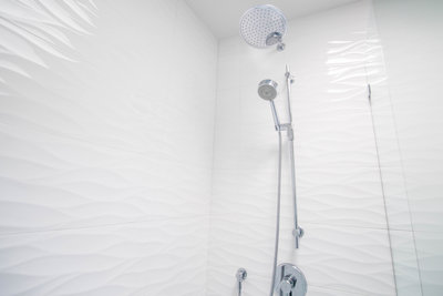 White textured tile in bathroom