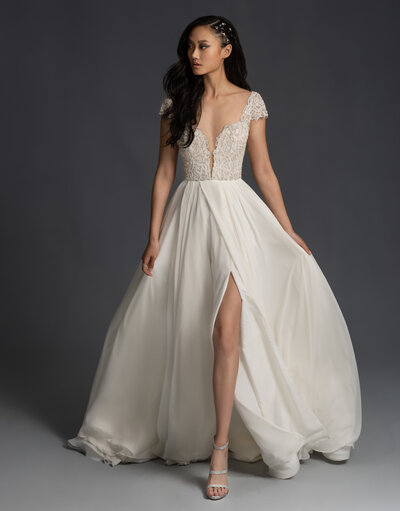 Hayley Paige bridal gown - Ivory pearl and opal beaded cap sleeve gown, plunging sweetheart neckline with illusion net insert and side cut outs, draped chiffon A-line skirt with slit.