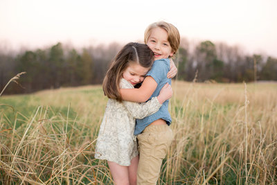 Children embrace in a field in Atlanta
