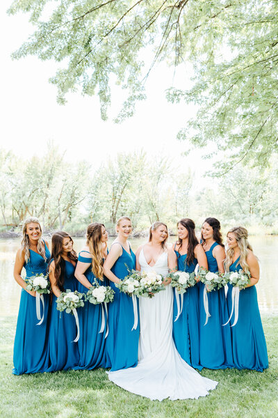 Bridesmaids in Blue by the River at White Willow Estate Wedding in Star, Idaho