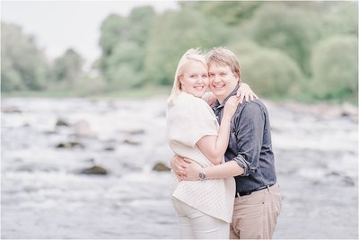 light and airy couples engagement portrait  next to the river tweed in natural surrounding