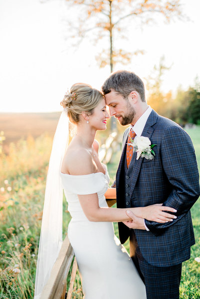 The Gathering Place Alaska wedding bride and groom sunset fall