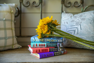Stack of books with flowers