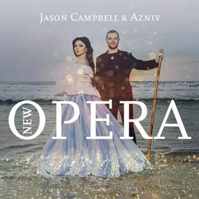 Album Cover New Age Opera Jason Campbell standing in water on beach holding tall wood flute Azniv standing beside him in pale blue ballgown shawl wrapped around shoulers