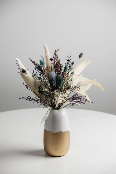 sand and stone dried floral arrangement