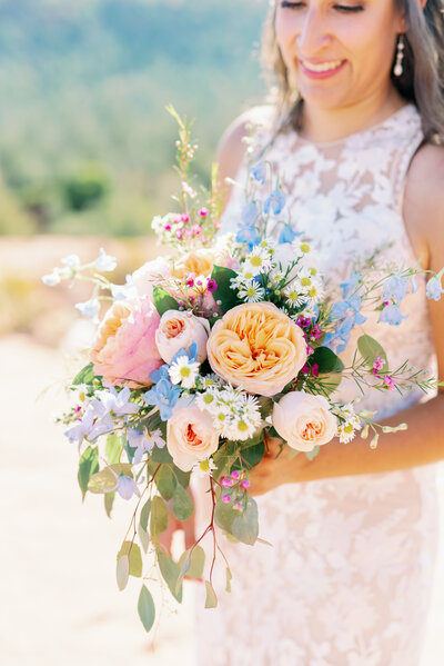 cathedral rock elopement with colorful bridal bouquet and bride