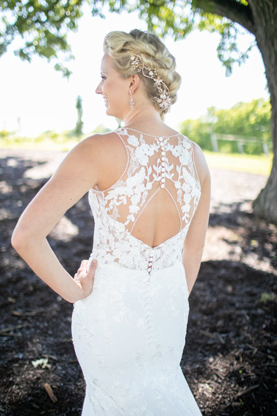 View of the back of a bride's beautiful wedding gown at Providence Vineyard in Hebron, IL