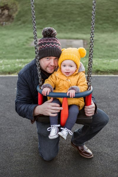 Shaun Turner with Daughter on the swing